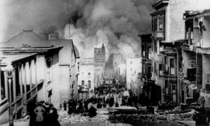 People on Sacramento street watch smoke rise from fires after an 8.3e earthquake hit in San Francisco, 1906.