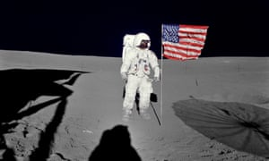 Edgar Mitchell standing by the US flag on the Moon's surface during the early moments of Apollo 14's first spacewalk