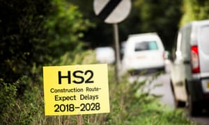 A sign by the side of a road, reading: 'HS2 construction route – expect delays 2018-2028'