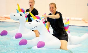 Beth Mead and Siobhan Chamberlain on inflatable unicorns at a Lionesses recovery session.