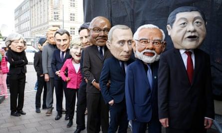 Protesters dressed like G20-leaders in Hamburg on Sunday.