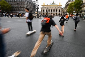People skate on the Opera Avenue in the French capital