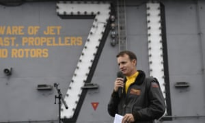 U.S. Navy Capt. Brett Crozier, commanding officer of the aircraft carrier USS Theodore Roosevelt (CVN 71), addresses the crew during an all-hands call on the ship's flight deck while conducting routine operations in the Eastern Pacific Ocean, last November.