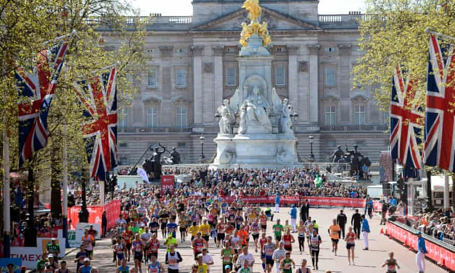 Runners arrive at the finish line at The Mall during the London Marathon.