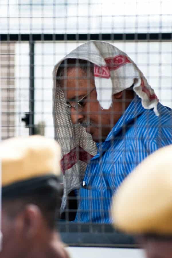Subash Kapoor in a prison bus outside Jayankondam court in Tamil Nadu.