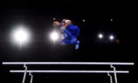 Britain's Joe Fraser flies high on his way to winning gold on the parallel bars at the world championships in Stuttgart.
