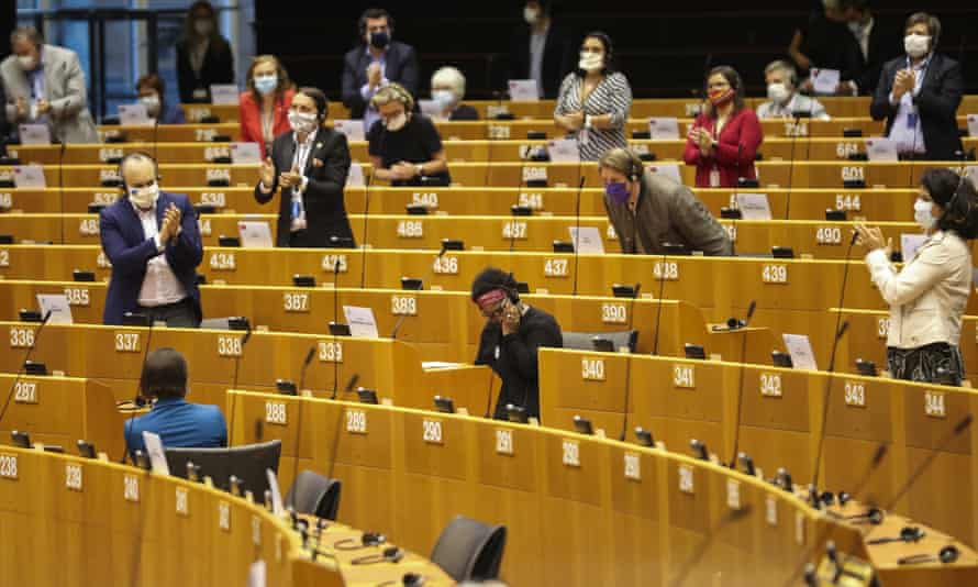 Pierrette Herzberger-Fofana is applauded by other MEPs after she speaks during a plenary session at the European parliament in Brussels