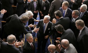 Netanyahu shakes hands as he leaves the House chamber on Capitol Hill.