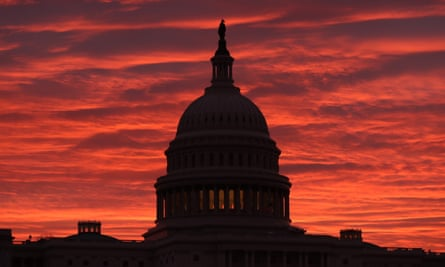 The sky turns a fiery color as the sun begins to rise behind the US Capitol this week.