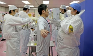 Fukushima workers are scanned for radiation exposure