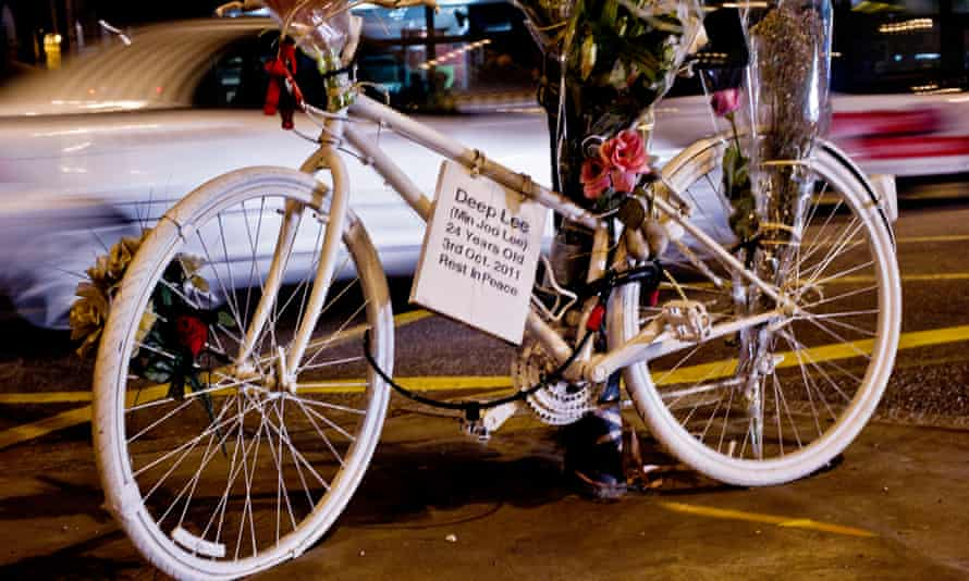 Bicycle memorial with bouquet