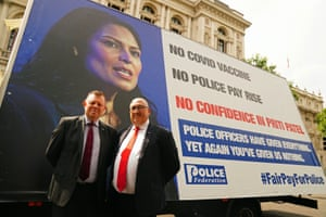 John Apter (left), chair of the Police Federation of England and Wales, and Ken Marsh, chair of the Metropolitan Police Federation, standing in front of an advertising van today as they delivered a letter to Boris Johnson in Downing Street complaining about police officers having their pay frozen.