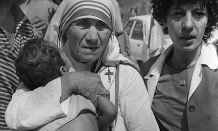 Mother Teresa carries a child in Beirut in August 1982.