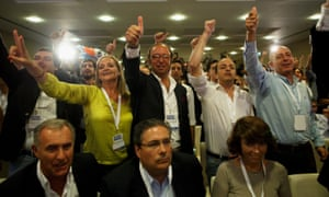 Supporters of the Portugal Ahead coalition listen to the first exit polls.