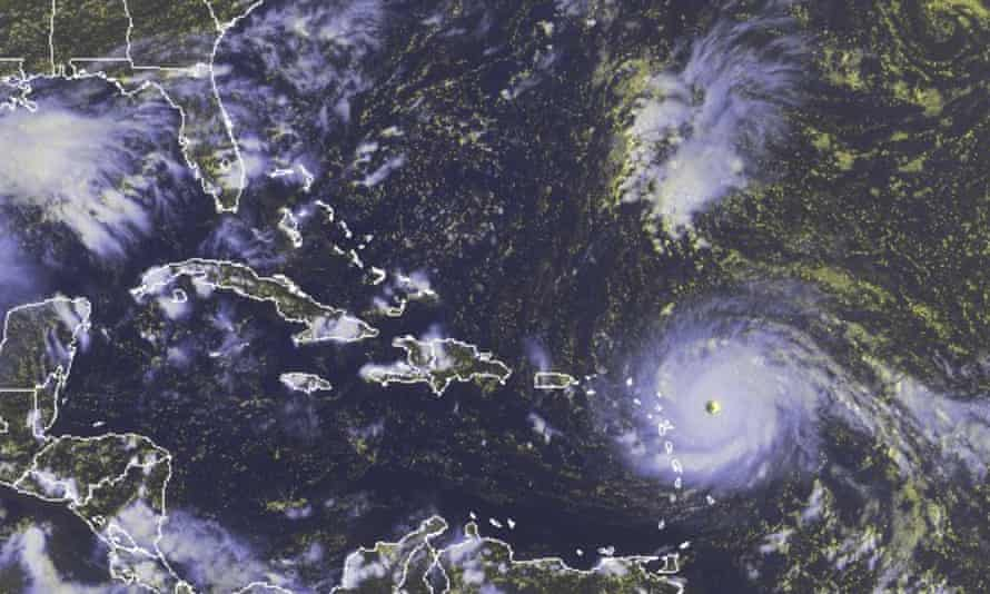 In this GOES-East satellite image Hurricane Irma, a potentially catastrophic category 5 hurricane, moves westward in the Atlantic Ocean.