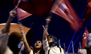 Pro-Erdoğan supporters wave Turkish national flags during a rally at Taksim square in Istanbul, several days after the failed coup.