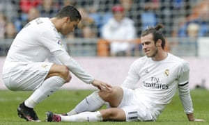 Gareth Bale goes down injured as Cristiano Ronaldo shows his concern.