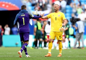 The two keepers Mathew Ryan and Kasper Schmeichel shake hands after their 1-1 draw.