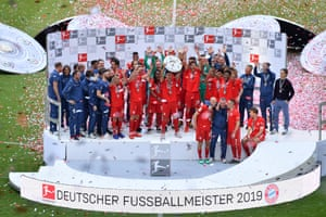 James Rodríguez of FC Bayern München celebrates with the title trophy with teammates following the Bundesliga.