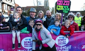 Zoe Ball with her father Johnny and family at the finish line in Brighton