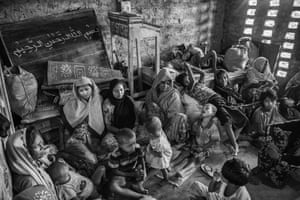 Rohingya refugees rest in a madrasa after arriving by boat at Shah Porir Dwip