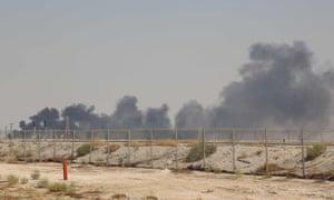 Smoke billows from an Aramco oil facility in Saudi Arabia