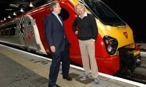 Tony Blair (left) with Virgin entrepreneur, Sir Richard Branson, at Euston Station, London, in 2004.