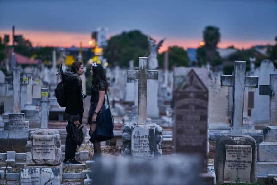Still from Boys in the Trees showing Corey (Toby Wallace) and Romany (Mitzi Ruhlmann) at Cemetery