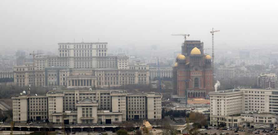 Aerial view of the Cathedral of National Redemption (right), flanked by the parliament building in Bucharest
