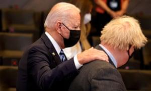 Joe Biden speaking with Boris Johnson during a Nato summit earlier this year.
