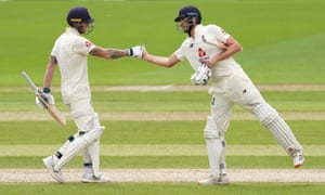 Ben Stokes (left) and Dom Sibley punch gloves during second Test against West Indies at Old Trafford in their stand of 260.