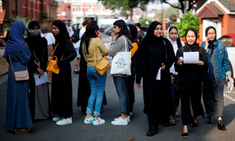 England A-level downgrades hit pupils from disadvantaged areas hardest