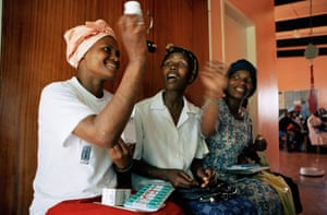 An HIV patient receives the antiretroviral drug Triomune, in South Africa.