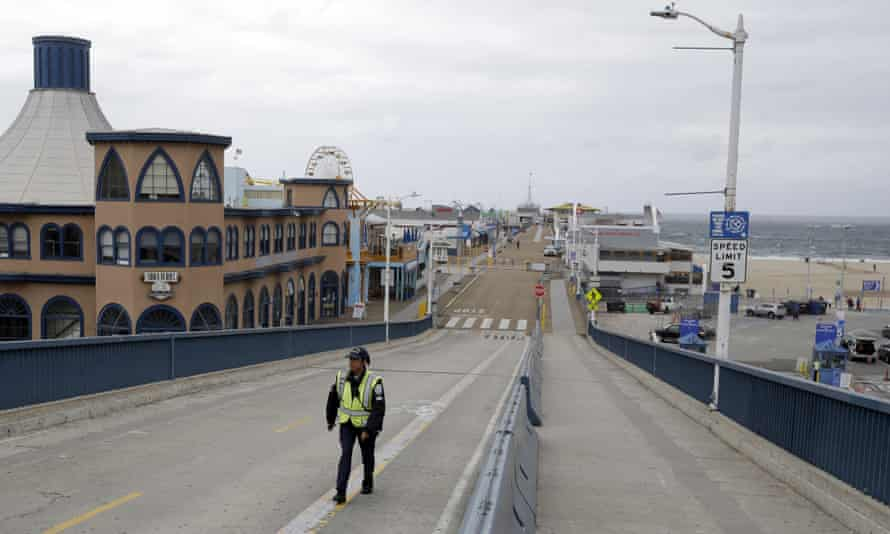 The Santa Monica Pier sit nearly empty following a temporary closure as part of measures to combat the spread of the coronavirus on Monday.