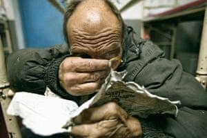 Eduard Goroschenya (nicknamed 'Bedya') reads an old newspaper clipping