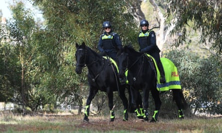 Victoria police mounted branch officers on patrol in Royal Park, Melbourne