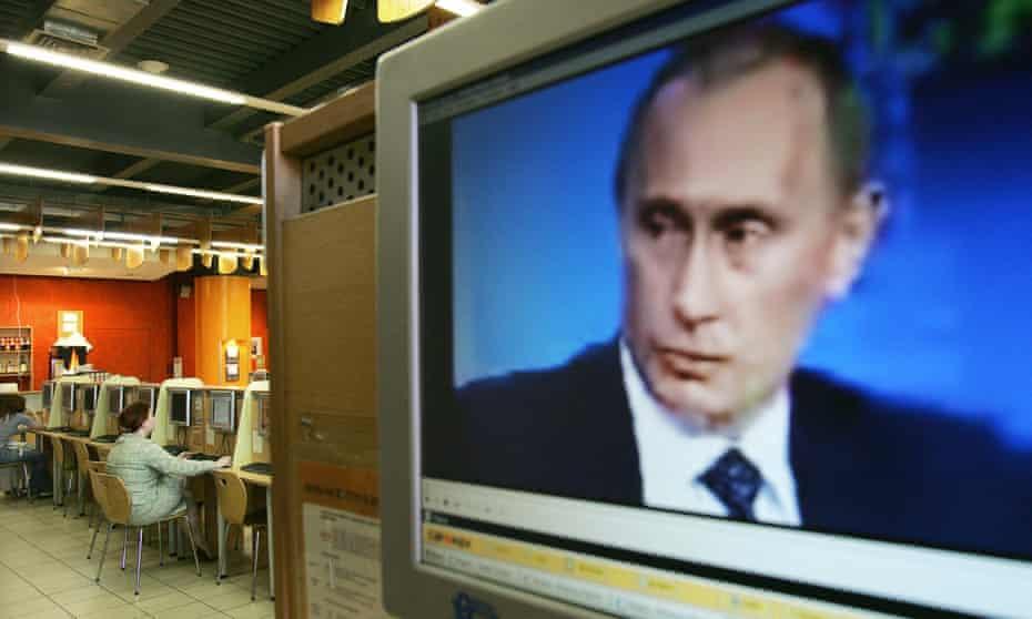 Vladimir Putin on a computer screen in an internet cafe.