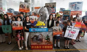 Anti-ivory activists protest outside the legislative council in Hong Kong, China on 6 June 2017.