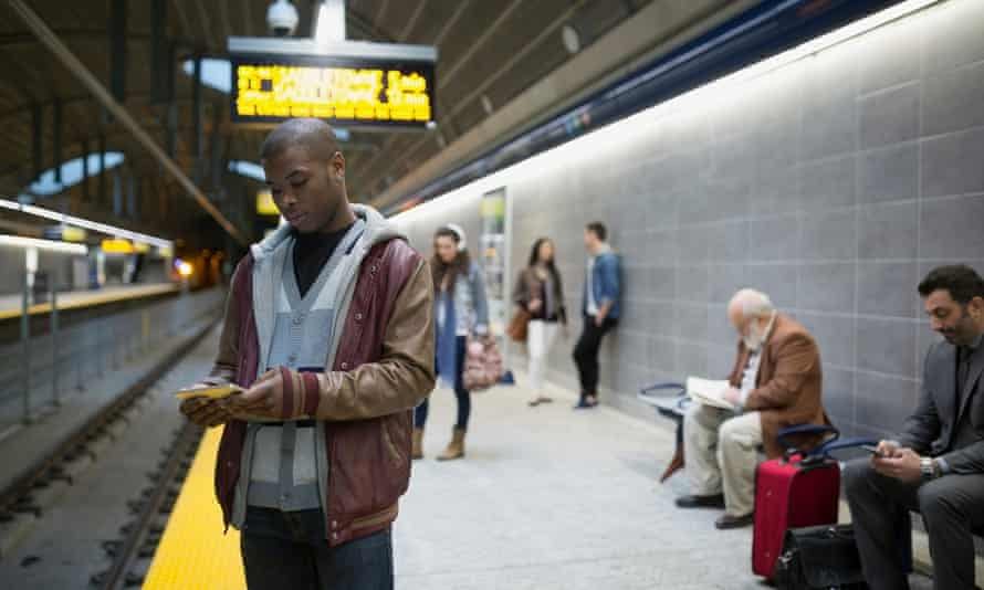 Commuters on subway station in Canada.