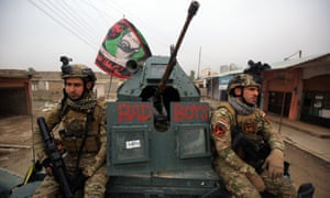 Iraqi pro-government forces patrol the eastern part of Mosul during the military operation against Islamic State militants.