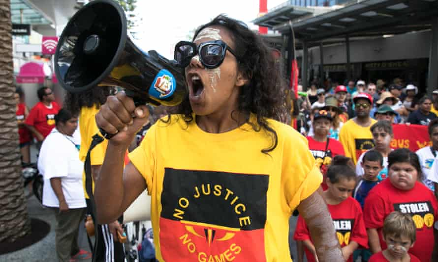 Ruby Wharton rallies members from the Stolenwealth Games protest group in Surfers Paradise.