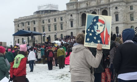 A protester holds sign at the Minnesota Women's March in front of the state capitol in St Paul on Saturday.