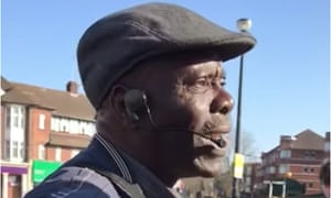 Oluwole Ilesanmi pleads with a police officer outside Southgate tube station.