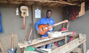 Patron Palushang, 36, is a guitar maker from Bukavu in the eastern Democratic Republic of the Congo. He has set up a business in Dzaleka.