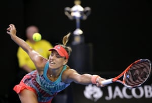 Kerber stretches to make a forehand return.
