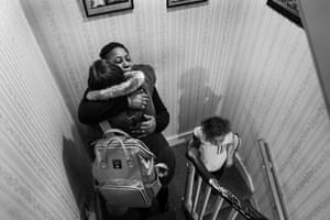 Peggy greets Lauren on the stairs in Hermine's Brixton home, from Windrush generation portraits by Jim Grover