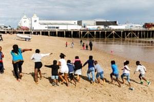 Children  running along beach
