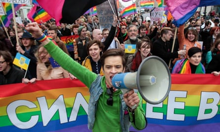 A gay rights activist leads a rally on Labour Day in St Petersburg, where the ban on 'gay propaganda' was first introduced.