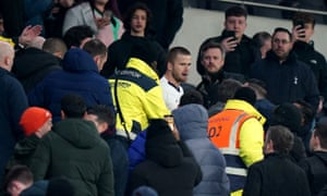 Eric Dier confronts a supporter in the stands following Tottenham's defeat.