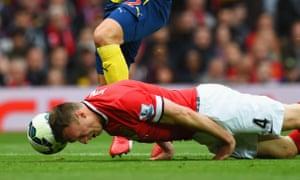 Phil Jones makes a memorable 'head tackle' against Arsenal.
